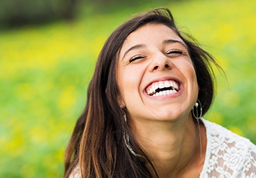 Happy young woman with healthy smile