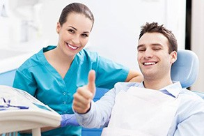 Thumbs up man in dental chair