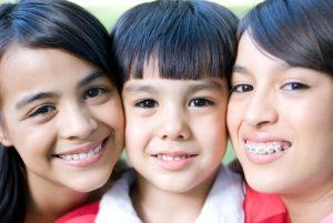 Kids smiling after visiting family dentist